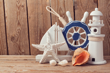 Marine lifestyle decorations over wooden background