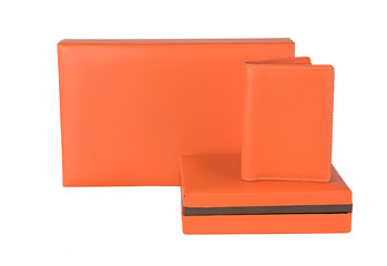 Orange leather wallet and gift box set isolated on white  backgr