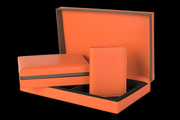 Orange leather wallet and gift box set isolated on black backgro