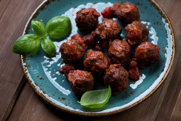 Close-up of meatballs with tomato sauce, selective focus