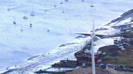Aerial view of a UK coastal wind turbine