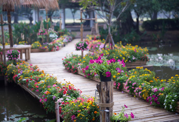 Beautiful flower garden with bamboo path