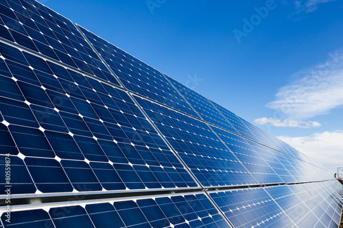 Leinwandbild Motiv Row of solar panels and sky