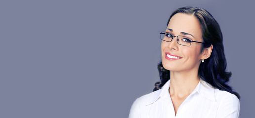 Portrait of cheerful young businesswoman in glasses