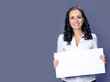 Young businesswoman showing blank signboard