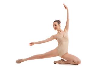young pretty ballet dancer sitting in elegant pose