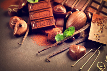 Chocolates background. Praline chocolate sweets