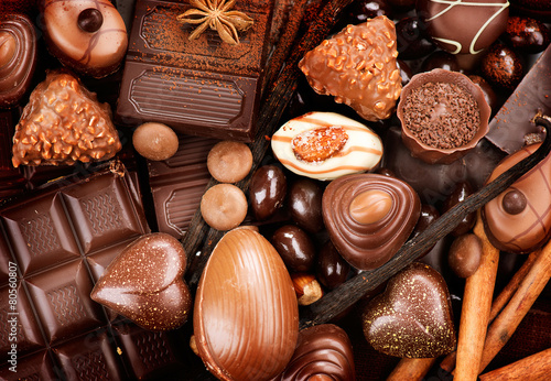 Poster Snoepjes Chocolates background. Praline chocolate sweets