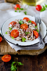 Rice with cod liver and tomatoes