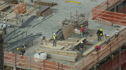 Construction workers on a rooftop building site