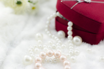 Pearl necklace and bracelet with red jewel box