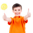Happy boy with colored candy showing thumbs up sign.