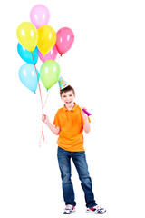 Happy boy holding colorful balloons.