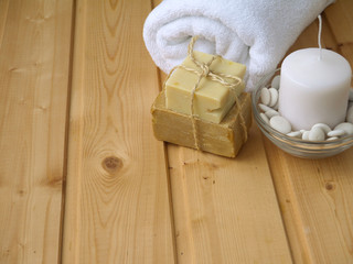 Towel,soap and candle on the wooden background
