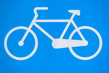 Blue bicycle sign closeup
