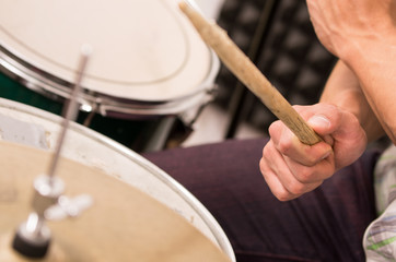 closeup shot of musician playing drums