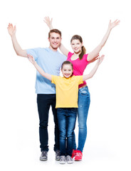 Cheerful family with child raised hands up.