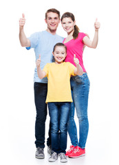 Happy family with child shows the thumbs up sign.