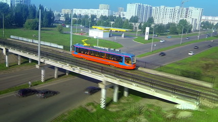 Aerial panorama follow track shot of modern new tram rides
