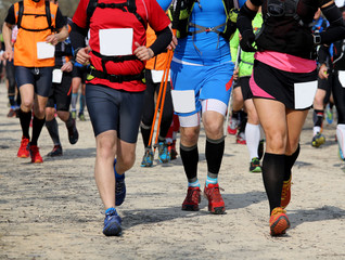Racing athletic during the race of nordic walking
