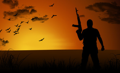 Silhouette of a lone soldier suicide at sunset