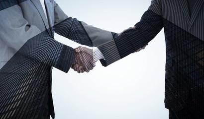 Composite image of handshake in agreement
