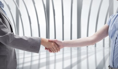 Composite image of handshake between two women