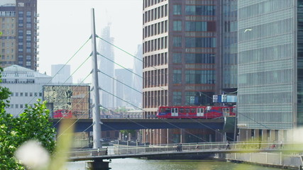 View from a distance of a train passing over the River Thames in London