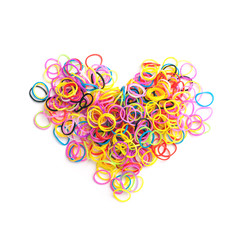 Small round colorful rubber bands in heart shape