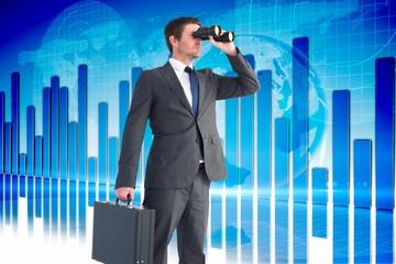 Composite image of businessman looking through binoculars