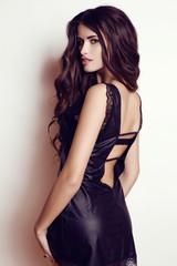 beautiful woman wtih luxurious dark hair in elegant black dress