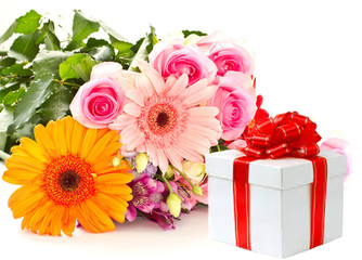 A bouquet of flowers and a gift.