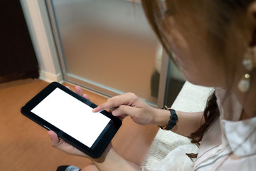 Woman using a tablet with blank white screen