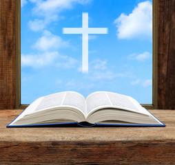 Bible open christian cross light sky view window wooden
