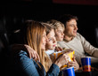 Family Of Four Watching Movie In Theater - 80573458