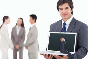 Composite image of businessman sitting