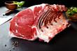 canvas print picture - Carne fresca y cruda.Costillas y chuletas de cerdo fondo negro