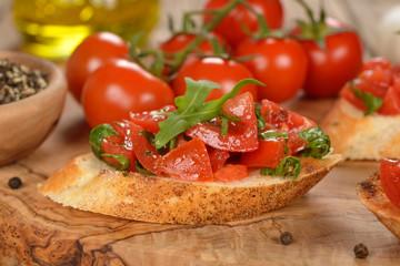 Bruschetta with tomatoes and arugula