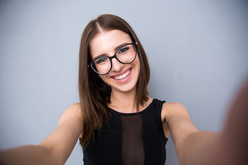 Portrait of a smiling cute woman in glasses