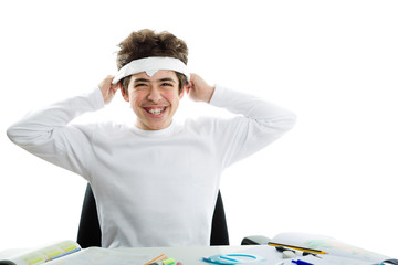 Boy is tying around the forehead a white handkerchief