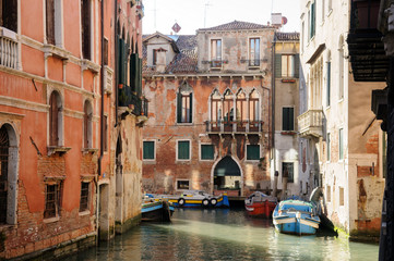 Canal with historic buildings in Venice - Italy