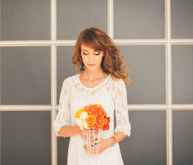 loving bride with a bouquet of flowers. morning