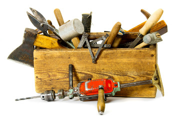 Working tools (drill, axe, saw and others) in an old box on