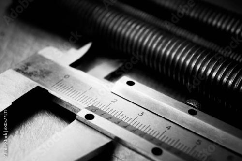 caliper and hairpins on scratched metal background. - 80577211