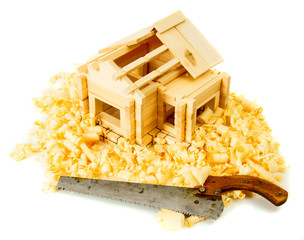 House construction. Joiner's works. The small wooden house, saw