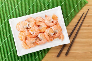 Cooked shrimps and chopsticks