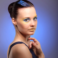 beautiful young woman with blue creative make-up