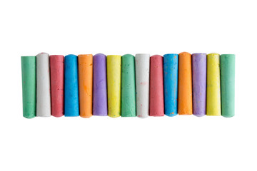 Long row of chalks in the colors of the rainbow
