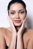 woman with dark hair and radiance health skin poster