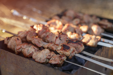 cooking pork shashlik on skewer in mangal outdoor food